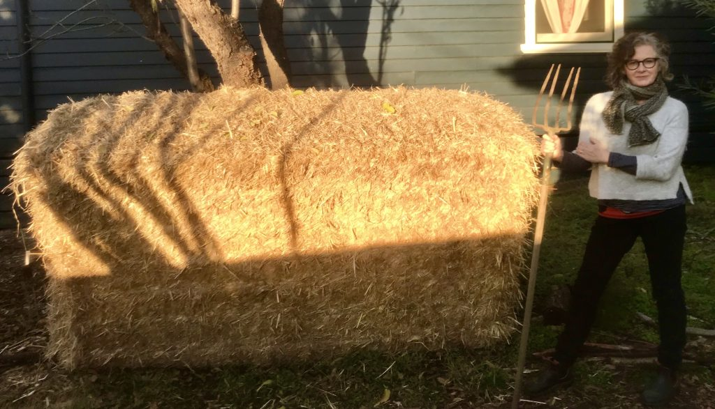 melinda with a giant straw bale